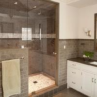 Shelter Interiors LLC - bathrooms - white and gray bathroom, white walls, white bathroom walls, seamless glass shower, gray subway tile shower, gray subway tile backsplash, gray tiled floor, gray tile bathroom floor, gray subway tile shower surround, rain shower head, marble shower floor, mosaic marble shower floor, white bathroom cabinets, gray quartz countertops, gray tiled mirror, gray bathroom mirror, grey subway tile,