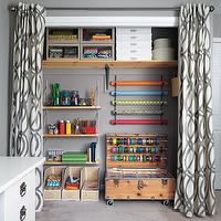 Real Simple - dens/libraries/offices - wrapping paper station, gray walls, craft room, gray walls, closet wrapping station, closet wrapping nook, closet wrapping room, closet turned into wrapping station, grommet curtains, grommet drapes, white and gray drapes, white and gray curtains, white and gray grommet drapes, white and gray grommet curtains, geometric drapes, geometric curtains, vintage trunk, wrapping paper,