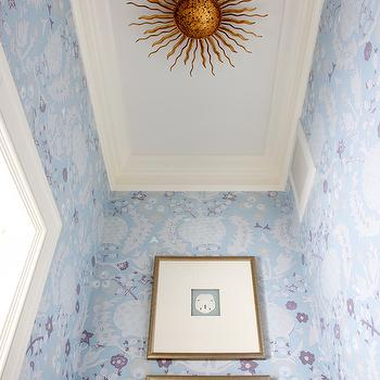 Sara Tuttle Interiors - bathrooms - blue botanical wallpaper, powder room, traditional powder room, blue wallpaper, traditional blue wallpaper, botanical wallpaper, blue floral wallpaper, framed seashells, framed silver dollars, gold framed seashells, ceiling mount sunburst light fixture, sunburst ceiling fixture, flush mount sunburst fixture, blue ceiling, blue powder room ceiling, crown molding, Visual Comfort Lighting Suzanne Kasler Re Flush Mount in Gilded Iron, sunburst light fixture, gold sunburst light fixture, sunburst flush mount, gold sunburst flush mount,