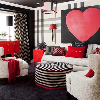 Jennifer Brouwer Design - living rooms - bold living room, black wall, oversize plaid wall, plaid wall, red white and black plaid wall, black wall sconce, red shade, canvas art, art over sofa, black and red heart canvas, heart canvas, white sofa, red button pillow, black and white pillow, navy pillow with red polka dots, embroidered accent pillow, red end table, red side table, black coral, black and white striped ottoman, red piping, round striped ottoman, black and white striped round ottoman, ivory accent chairs, ivory upholstered armchairs, red console table, red buffet table, polished nickel lamps, polished nickel buffet lamps, hardwood floors, black rug, black area rug, black ceiling, black painted ceiling, black and white chevron drapes, chevron drapes, chevron curtains, black and white chevron curtains, red throw blankets, modern pendant, modern lantern, black and white chevron drapes,