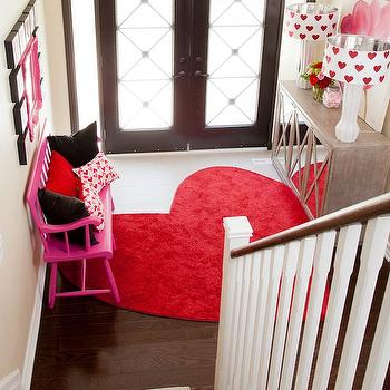Jennifer Brouwer Design - entrances/foyers - hardwood floors, white tiled entryway, white tiled foyer, contemporary front door, double front door, double entryway door, front door, frosted glass front door, hot pink bench, pink bench, red pillow, black pillow, heart patterned pillow, red heart shaped rug, heart shaped rug, mirror fronted buffet, mirror fronted cabinet, white table lamps, modern white table lamps, white drum shade with red hearts, red heart patterned drum shade, pink mirror, mini canvases, buttermilk colored walls, buttermilk wall color, leaning canvas, flower canvas, flower print canvas,