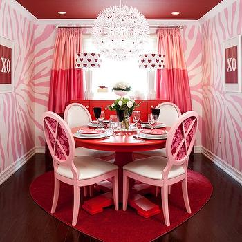 Jennifer Brouwer Design - dining rooms - red ceiling, recessed lighting, pot lights, red painted ceiling, painted red dining room ceiling, pink and white zebra print walls, zebra print walls, pink and white animal print walls, x o framed prints, red and pink tonal silk drapes, red and pink tonal silk curtains, red and pink striped drapes, red and pink striped curtains, red buffet, red buffet table, buffet table in front of window, modern white table lamps, red heart patterned shades, drum shades with red heart pattern, red pedestal dinning table, round red pedestal dining table, modern louis chairs, pink dining chairs, red and pink damask backed dining chairs, Ikea PS Maskros Pendant, hardwood floors, dark hardwood floors, red heart shaped rug, heart shaped rug, heart rug, pink dining room,