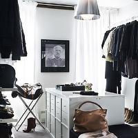 closets - walk in closet, walk in closet design, bedroom converted to closet, bedroom converted into closet, rustic beams, rustic wood beams, white walls, closet island, white lacquer closet island, jewelry drawers, closet island drawers, closet island storage, clothes rods, shelves for shoes, shoe shelves, modern chandelier, his and her closet,