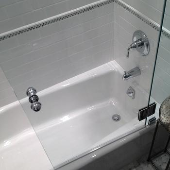 Courthouse Contractors - bathrooms - guest bath, guest bathroom drop in tub, drop in bathtub, subway tile bathroom, subway tile shower, subway tile shower surround, decorative stripe tile, mosaic strip tiles, shower partition, shower partition, glass partition, glass shower partition,