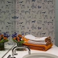 Sally Steponkus Interiors - bathrooms - boys bathroom, dog wallpaper, boys bathroom wallpaper, white and blue dog wallpaper, frameless glass mirror, cream quartz countertop, cream countertops, cream bathroom countertops, round sink, basin sink, round basin sink, orange accents, boys bathroom accents,
