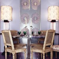 House Beautiful - dining rooms - Benjamin Moore - Spring Iris - lavender paint, lavender walls, lavender paint color, lavender dining room, purple dining room, modern dining table, lucite table, lucite dining table, french chairs, cane chairs, french cane chairs, purple floor,