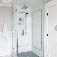 Style at Home - bathrooms - glass shower, corner shower, corner glass shower, beveled subway tile shower, beveled subway tile shower surround, black tile shower floor, black shower floor, mosaic tile shower floor, black mosaic tile shower floor, rain shower head, nickel shower caddy, shower caddy, gray walls, gray bathroom walls, beveled subway tile backsplash, beveled subway tile wall, marble tile lfoor, marble bathroom floor, white beveled subway tile, white beveled subway tile shower,