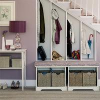 entrances/foyers - foyer, under stair storage, under stairs storage, staircase storage, staircase built-ins, under stair storage, under staircase storage, bench, storage bench, woven baskets, open lockers, mudroom, foyer mudroom, purple walls, white console table, foyer table, console table, white console table, purple lamp, gourd lamp, purple gourd lamp,