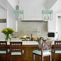 House Beautiful - kitchens - modern cottage kitchen, cottage kitchen, iridescent til, iridescent backsplash tiles, iridescent tile kitchen, iridescent kitchen tiles, iridescent subway tile, iridescent subway tile backsplash, cooktop tile, cooktop backsplash, turquoise lanterns, turquoise blue lanterns, kitchen lanterns, kitchen island lanterns, large kitchen island, stained kitchen island, marble countertops, beveled marble countertops, marble island, marble kitchen island, wood bar stools, turquoise blue bar stools, wood kitchen hood, cabinets over refrigerator, cabinets over refrigerator, double door refrigerator, wood refrigerator, double door refrigerator, wood panel refrigerator, kitchen tv tv in kitchen, cabinet mounted tv, tv mounted on cabinet, box beams, urban electric chisholm hall, chisholm hall lantern,