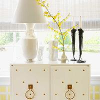 House Beautiful - living rooms - studded cabinet, brass studded cabinet, hollywood regency lamp, black candlesticks, vignette,  Ann Pyne of McMillen