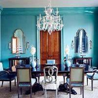 House Beautiful - dining rooms - turquoise dining room, turquoise blue dining room blue dining room, turquoise crown moldings, turquoise moldings, turquoise blue crown moldings, turquoise blue moldings, turquoise curtains, turquoise blue curtains, turquoise drapes, turquoise blue drapes, turquoise window panels, turquoise blue window panels, pinch pleat curtains, silk curtains, turquoise ilk curtains, turquoise walls, turquoise blue walls, bi fold doors, rustic bi fold doors, mirrored cabinets, dining room cabinets, antique dining table, mismatched chairs, mismatched dining chairs, turquoise dining chairs, turquoise blue dining chairs, turquoise velvet chairs, turquoise velvet dining chairs, 3-tier chandelier, crystal chandelier,
