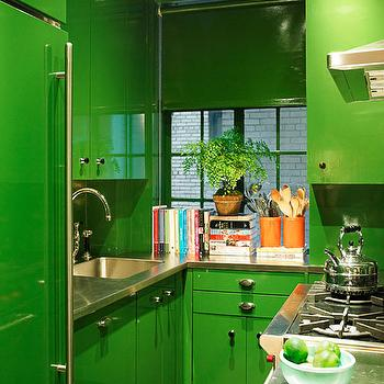 House Beautiful - kitchens - green kitchen, green cabinets, green kitchen cabinets, painted cabinets, painted kitchen cabinets, green refrigerator, stainless steel countertops, gooseneck faucet, small kitchen, efficient kitchen, green vinyl shade, green kitchen shade, vinyl window shades, green window treatments, bright green cabinets, bright green kitchen cabinets,