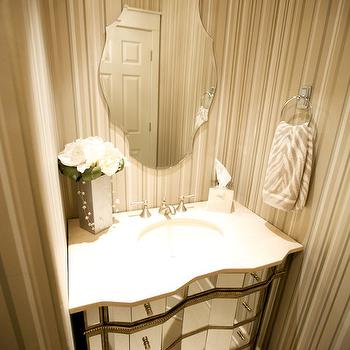 J and J Design Group - bathrooms - mirrored bathroom vanity, frameless mirror, striped walls, powder room, striped powder room, striped powder room walls, mirrored bathroom cabinet, frameless bathroom mirror, small powder room, glam powder room, glamorous powder room,