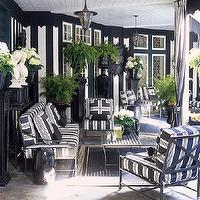 House Beautiful - decks/patios - Ralph Lauren - Bone Black - black and white patio, black and white patio design, chic patios, black and white striped walls, vertical striped walls, black and white vertical striped walls, column pedestals, black column pedestals, black planters, black garden stools, greek busts, garden greek busts, wrought iron furniture, outdoor furniture, black and white cushions, black and white striped cushions, black and white striped furniture, black and white striped sofas, black and white striped chairs, mitered pillows, black and white pillows, black and white mitered pillows, beadboard ceiling, outdoor curtains, outdoor drapes, black and white striped curtains, black and white striped drapes, black and white striped outdoor curtains, black and white striped outdoor drapes,