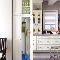 Martha Stewart - kitchens - martha stewart cabinets, crate and barrel spin counter stools, martha stewart nimbus cloud, bedford marble, ivory cabinets, ivory kitchen cabinets, ivory cabinetry, ivory kitchen, bedford marble counters, bedford marble countertops, bedford marble backsplash, storage cabinet, kitchen storage, utility storage, utility cabinet, stamped concrete floors, gray stamped concrete floors, glass fronted upper cabinets, gray walls, gray wall color, , Crate &amp; Barrel Spin Counter Stool,