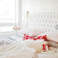 Style at Home - bedrooms - ethereal bedroom, silvery tone-on-tone wallpaper, tone-on-tone wallpaper, ivory damask wallpaper, tufted white headboard, white headboard, tufted headboard, grey dotted bedding, cream throw, mongolian wool pillow, geometric red and white pillow, modern white table lamp, white nightstand, silver vase, peach flowers, ivory wallpaper, peach pillows, neutral bedroom, feminine bedroom, white table lamp, mini canvases, velvet headboard, velvet tufted headboard, white velvet tufted headboard,