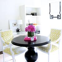 Ferreira Design - dining rooms - black dining table, black round dining table, white arm chair, sisal rug, layered rugs, white cow hide rug, white hide rug, glossy black pedestal table, pedestal dining table, Kelly Wearstler Imperial Trellis Citrine fabric, chartreuse trellis fabric, hot pink books, vase of pink flowers, large drum pendant, drum pendant, drum pendant with light diffuser, white bookshelf, glass topped desk, white window blind, black applique trim, black ribbon trim, black and white blind, white walls, glass table lamp, yellow and black dining room, yellow and black room, greek key, greek key trim, greek key roman shade, grosgrain roman shade,