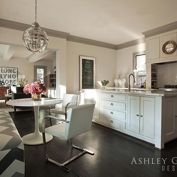 Ashley Goforth Design - kitchens - gray kitchen, white and gray kitchen, light gray walls, light gray kitchen walls, gray crown molding, gray molding, gray kitchen molding, gray kitchen molding, glass globe pendant, globe pendant, banded globe pendant, eat in kitchen, kitchen dining space, saarinen table, marble saarinen table, brno chairs, flat bar chairs, white brno chairs, white flat bar chairs, custom bench, custom dining bench, chevron bench, chevron banquette, dining banquette, gray and black banquette, gray and black bench, gray and black chevron bench, gray and black chevron banquette, hardwood dloor, dark wood floors, kitchen wood floors, wood kitchen hood, wood paneled hood, wood paneled kitchen hood, convex mirror, gold mirror, gold convex mirror, cooktop shelves, cooktop shelving, high end appliances, top of the line appliances, shaker cabinets, white shaker cabinets, marble countertops, subway tile backsplash, marble top kitchen island, marble kitchen island, kitchen island cabinets, kitchen island storage, sink in kitchen island, kitchen island sink, ginger jars, white ginger jars, dark stained wood floor, dark stained hardwood floor,