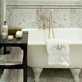 Sussan Lari Architect - bathrooms - marble bathroom, basket weave marble floor tile, basketweave marble tiled floors, black accent table, small black side table, wall mounted faucet, monogrammed towels, claw foot tub, claw foot bath tub, white claw foot tub, cast iron claw foot bath tub, marble tiled bathroom, marble tiled walls, black mini marble mosaic, marble accent tile, traditional marble bathroom, clawfoot tub, master bath clawfoot tub,