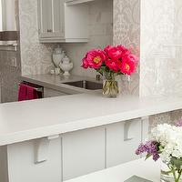 Caitlin Wilson Design - kitchens - white shaker cabinets, white shaker kitchen cabinets, brushed nickel hardware, quartz counters, quartz countertops, white quartz countertops, undermount sink, stainless steel undermount sink, damask wallpaper, gray damask wallpaper, marble tiled backsplash, marble tiled kitchen backsplash, marble kitchen backsplash, white kitchen cabinets, white breakfast table, white square breakfast table, white corbels, breakfast bar, breakfast bar peninsula, kitchen bar, bar peninsula, pearlescent damask wallpaper, ivory damask wallpaper, tonal damask wallpaper, hot pink flowers,