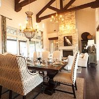 Southern Living - dining rooms - rustic wood beams, wood beams, kitchen beams, kitchen wood beams, exposed beams, plank ceiling, kitchen plank ceiling, white plank ceiling, recessed lighting, hardwood floors, dark wood floors, brown sisal rug, dining room rug, wall of french doors, wall of transom windows, french doors, transom windows, beaded chandelier, trestle table, trestle dining table, camelback bench, camelback banquette, custom banquette, camelback chairs, camelback dining chairs, cream dining chairs, cream camelback chairs, crea, camelback dining chairs, open floor plan,