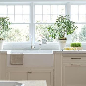 Lindy Weaver Design Associates - kitchens - cream cabinets, cream kitchen cabinets, shaker cabinets, shaker kitchen cabinets, cream shaker cabinets, cream shaker kitchen cabinets, marble countertops, farmhouse sink, gooseneck faucet, bank of windows, kitchen windows, kitchen topiary,