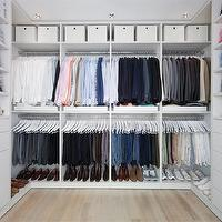 California Closets - closets: closet system, his closet, master closet, walk-in closet, custom walk-in closet, double hung clothes rack, storage bins, closet shelves, organized closet, closet storage, mirror backed shelves, brushed nickel hardware, bleached hardwood floors, recessed lighting, pot lights, recessed lights, closet drawers, walk in closet shelves, closet shelves,