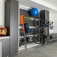 California Closets - garages - custom garage storage, garage storage, garage storage system, organized garage, garage cupboards, custom garage cabinets, custom garage cabinetry, wall system, storing athletic gear, wall system storage, hanging storage, uncluttered garage, modern garage storage, storage cupboards, garage wall storage, garage wall system,