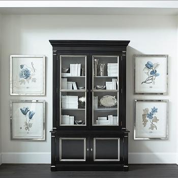 Linda McDougald Design - entrances/foyers - alcove, cabinet in alcove, black lacquered cabinet, black lacquered display cabinet, black cabinet, white bound books, heirloom silver, silver collection, mirrored frames, mirror framed botanicals, blue botanical prints, botanical prints, gray green walls, light gray green walls, ebony hardwood floors, black and silver cabinet, white baseboards, dark hardwood floors, glass front cabinet, glass front armoire, black armoire, black lacquer armoire,