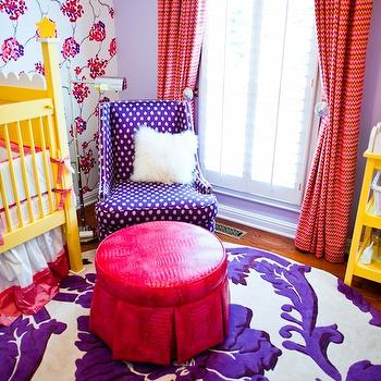 Natalie Clayman Interior Design - nurseries - purple and red nursery, girl nursery, girls nursery, bold nursery, bold girls nursery, bright baby girls nursery, wallpapered accent wall, purple wall color, purple walls, plantation shutters, pink pinstriped drapes, curtain tie backs, drapery tie back hooks, hardwood floors, purple and white rug, purple and white floral rug, yellow crib, bright yellow crib, pink and white crib bedding, hot pink ottoman, round hot pink ottoman, round hot pink faux snakeskin ottoman, round hot pink faux snakeskin pleated ottoman, hot pink pleated ottoman, plantation shutters, floor to ceiling drapes, ceiling height drapes, bright yellow changing table, yellow changing table, floral wallpaper, pink purple and white floral wallpaper, banded crib skirt, polished nickel floor lamp, purple polka dot gilder, purple polka dot chair, sheepskin pillow,