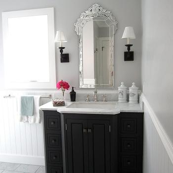 Classic Casual Home - bathrooms - gray walls, gray bathroom walls, venetian mirror, bathroom venetian mirror, venetian bathroom mirror, oil rubbed bronze sconces, black vanity, bathroom vanity, bathroom, black cabinet, black bathroom cabinet, marble countertops, french apothecary jars,
