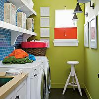 My Home Ideas - laundry/mud rooms - blue and green laundry room, apple green, apple green walls, bright green walls, art gallery, laundry room art gallery, bronze sconces, swing arm sconces, bronze swing arm sconces, art lights, art lighting, white stools, modern stools, modern white stool, black tile, black floor, diagonal tiles, black diagonal tiles, white washer and dryer, front load washer and dryer, laundry room shelf, laundry room shelves, laundry room shelving, corbels, white shelves, white laundry shelves, blue subway tile, blue subway tile backsplash, white cabinets, laundry cabinets, laundry room cabinets, white laundry cabinets, white laundry room cabinets, gold counters, gold countertops, laundry room storage,