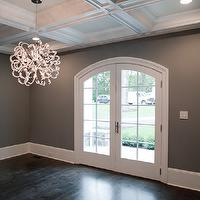 Michelle Winick Design - dining rooms - dark gray walls, dark gray wall color, dark gray dining room wall, dark gray dining room, coffered ceiling, recessed lighting, pot lights, ebony stained floors, red oak floors, hardwood floors, ebony floor stain, ebony stained red oak floors, modern chandelier, modern crystal chandelier, arched patio doors, arched doorway, arched double doors, wide baseboards, baseboards, mill work, dark hardwood floors,
