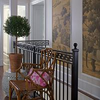 Northworks Architects - entrances/foyers - pink accents, second floor landing, chinoiserie chinoiserie design, hand rail, black hand rail, iron hand rail, greek key, greek key trim, greek key hand rail, chinoiserie art, art panels, chinoiserie art panels, stairwell art, stairwell, caramel bamboo chair, caramel chair, caramel colored chair, brown bamboo chair, bamboo chair, chinese garden stool, white garden stool, potted plant, chinoiserie room, greek keu handrail,