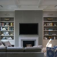 Northworks Architects - living rooms - marble fireplace, picture lights, built ins, family room, living room, gray family room, gray living room, gray built ins, buil tin cabinets, gray built in cabinets, bookshelf, gray bookshelf, built in bookshelf, bookshelves, built in bookshelves, gray bookshelves, gray built in bookshelf, gray bookshelves, gray built in bookshelves, coffered ceiling, coffered family room ceiling, family room coffered ceiling, white coffered ceiling, tv over fireplace, tv above fireplace, flatscreen over fireplace, flatscreen above fireplace, tv niche, tv nook, built in tv niche, built in tv nook, gray grasscloth, gray grasscloth wallpaper, sectional, sectional sofa, gray sectional, gray sectional sofa, silver pillows, ikat chair, blue ikat chair, white and blue ikat chair, fireplace tv niche,