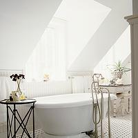 Elle Decor - bathrooms - white bathroom, attic bath, attic bathroom, attic master bath, attic master bathroom, white walls, white bathroom walls, waterworks fittings, waterworks bath fittings, kohler tub, freestanding tub, kohler freestanding tub, vintage tile, vintage tile floor, black and white tile, black and white tile floor, black and white floor, black and white bathroom floor, directoire table, bathroom table, bathroom accent table, whitewashed vanity, white washed vanity, vintage vanity, pedestals tool, vintage stools, vintage pedestal stool, shabby chic bathroom, sloped bathroom ceiling, white beadboard bathroom, beadboard bathroom,