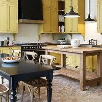 House &amp; Home - kitchens - Farrow &amp; Ball - Octagon Yellow - brick floor, brick kitchen floor, farmhouse sining table, black dining table, black farmhouse dining table, french cafe chairs, cafe chairs, salvaged wood island, salvaged wood kitchen island, restoration hardware island, restoration hardware kitchen island, restoration hardware pendant, vintage barn pendant, black vintage barn pendant, yellow cabinets, yellow kitchen cabinets, kitchen cabinets, kitchen, corbel, yellow corbels, cabinet corbels, custom hood, custom kitchen, black kitchen hood, custom black kitchen hood, white subway tile, white subway tile backsplash, la cornue, la cornue cornufe, la cornue stove, la cornue range, black la cornue, black la cornue stove, black la cornue range, gray countertops, caesarstone, caesarstone counters, caesarstone countertops, gray caesarstone counters, gray caesarstone countertops, yellow and black kitchen, yellow and black kitchen design,