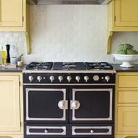House & Home - kitchens - Farrow & Ball - Octagon Yellow - yellow cabinets, yellow kitchen cabinets, kitchen cabinets, kitchen, corbel, yellow corbels, cabinet corbels, custom hood, custom kitchen, black kitchen hood, custom black kitchen hood, white subway tile, white subway tile backsplash, la cornue, la cornue cornufe, la cornue stove, la cornue range, black la cornue, black la cornue stove, black la cornue range, gray countertops, caesarstone, caesarstone counters, caesarstone countertops, gray caesarstone counters, gray caesarstone countertops, yellow and black kitchen, yellow and black kitchen design,