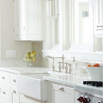 Caitlin Wilson Design - kitchens - white kitchen, white kitchen cabinets, white kitchen cabinetry, recessed panel kitchen cabinets, white recessed panel kitchen cabinets, polished nickel faucet, polished nickel bridge faucet, white cabinetry, farm sink, farmhouse sink, undermount farmhouse sink, white counters, white kitchen counters, white countertops, white quartz countertops, oyster gray backsplash tile, gray subway tile, gray subway tile backsplash, gray beveled subway tile, beveled subway tile,
