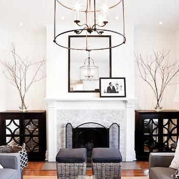 Lux Decor - living rooms - monochromatic living room, white walls, white wall color, recessed lighting, pot lights, traditional fireplace, marble mosaic fireplace, mini marble mosaic fireplace surround, mirror fronted cabinets, black mirror fronted cabinets, mirror fronted cabinets flanking fireplace, black mirrored chest, glass vase, branches in vase, black mirror, black fireplace mirror, iron floor lamp, gray rattan stools, gray sofa, fireplace ottomans, contemporary gray sofa, white pillow, gray trellis pillow, fireplace screen, white drapes with solid black border, white drapes with black edge, white curtains with black border, white curtains with solid black edge, iron lantern pendant, large lantern pendant, large open lantern pendant, symmetrical living room, symmetrical living room arrangement, face to face sofas, sofas facing each other, modern gray sofas, gray sofa, black and white curtains, black and white drapes, black and white window panels, fireplace alcoves,