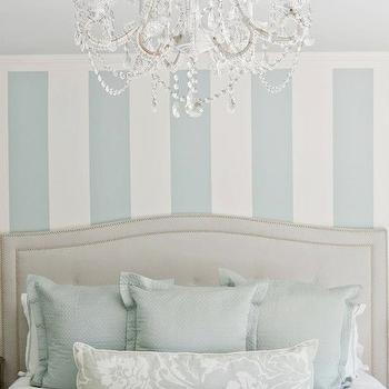 Lux Decor - bedrooms - serene bedroom, blue and white bedroom, blue and white striped walls, blue and white striped accent wall, accent wall behind headboard, vertical stripes, painted vertical stripes, blue and white painted vertical striped wall, linen headboard, tufted linen headboard, linen headboard with nailhead trim, light blue linen pillows, light blue linen euro shams, white bedding, white bed linens, white duvet cover, blue damask pillow, blue damask accent pillow, white chandelier, whited crystal chandelier, pretty bedroom, feminine blue bedroom, blue and gray bedroom, blue and gray room, gray headboard, camelback headboard, gray camelback headboard, gray tufted headboard, light gray headboard, gray nailhead headboard,
