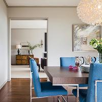 Cheryl Burke Interior Design - dining rooms: misty gray walls, gray walls, gray wall color, gray trim, gray trim color, contemporary dining table, vintage dining chairs, retro dining chairs, blue dining chairs with chrome base, wood veneer topped dining table with chrome base, chrome based dining table, retro style dining table, Milo Baughman chairs, Milo Baughman dining chairs, blue dining chairs, blue milo baughman chairs, retro blue dining chairs, hardwood floors, contemporary chandelier, contemporary pendant, gray abstract art, framed abstract art, Ango Chandelier Studio Work Shops, retro dining room, vintage dining room furniture,