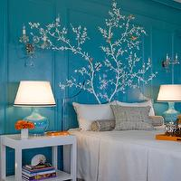 Kendall Wilkinson Design - bedrooms - turquoise bedroom, turquoise paneled walls, acrylic headboard, paneled walls, molding, wall moldings, turquoise walls, turquoise wall color, natural fiber carpet, chocolate brown carpet, box pleated linen coverlet, box pleated coverlet, linen coverlet with brown ribbon trim, orange serving tray, orange tray, traditional bedroom, turquoise and orange bedroom, teal and orange bedroom, hand painted mural, branch mural, birds and tree mural branches and birds hand painted mural, hand painted mural over wood paneled walls, camouflaged paneled headboard, white parsons nightstand, parsons nightstand, glossy turquoise table lamps, turquoise table lamps, orange flowers, stacked books, nautilus shell, bolster pillow, brown geometric bolster pillow, ivory and brown pillow, mural over bed, hand painted mural over bed, feminine mural, gold and crystal wall sconces, gilt wall sconces, blossom branch mural, tree mural, hand painted tree mural, turquoise and orange bedroom, turquoise blue and orange bedroom, orange accents,