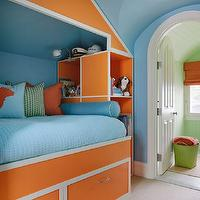 Kendall Wilkinson Design - boy's rooms - bed built into niche, bed built into rafters, built-in bed, built-in kids bed, orange and white kids bed, bed built into pitched ceiling, custom built-in bed, kids bed, kids storage bed, kids bed with storage cubbies, kids bed with storage drawers, bright blue walls, blue walls, blue wall color, blue bedding, blue coverlet, sky blue coverlet, orange and blue dog silhouette pillow, green and white striped pillow, orange pillow, blue bolster pillow, arched doorway, orange and blue kids room, orange and blue kids bedroom, blue and orange boys room, blue and orange boys bedroom,