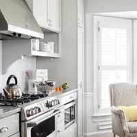 TerraCotta Properties - kitchens - cream cabinets, cream kitchen cabinets, shaker cabinets, cream shaker cabinets, cream shaker kitchen cabinets, cooktop shelves, cooktop shelving, open shelving, kitchen open shelving, open shelves, corbels, kitchen corbels, subway tile backsplash, kitchen hood, stainless steel kitchen hood, gas range, stainless steel range, microwave nook, built in microwave, built in microwave nook, floor to ceiling cabinets, floor to ceiling pantry cabinets, oak wood floors,