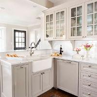 TerraCotta Properties - kitchens - gray cabinets, kitchen cabinets, gray kitchen cabinets, shaker cabinets, gray shaker cabinets, gray shaker kitchen cabinets, marble top, marble countertop, white subway tile, white subway tile backsplash, kitchen hood, disguised kitchen hood, hidden cabinet, hidden kitchen cabinet, end cabinets, gray end cabinets, hidden cabinets, secret cabinets, hidden end cabinets, secret end cabinets, gray corbels, farmhouse sink, kitchen peninsula, gray kitchen peninsula, gooseneck faucet, gray dishwasher, wood dishwasher, gray wood dishwasher, wood paneled dishwasher, gray paneled dishwasher, L shaped kitchen, light gray cabinets, light gray kitchen cabinets,