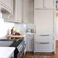 TerraCotta Properties - kitchens - gray cabinets, kitchen cabinets, gray kitchen cabinets, marble top, marble countertop, white subway tile, white subway tile backsplash, kitchen hood, disguised kitchen hood, hidden cabinet, hidden kitchen cabinet, gray kitchen hood, wood paneled hood, gray kitchen hood, gray paneled hood, gray paneled kitchen hood, wood fridge, gray fridge, gray refrigerator, gray wood fridge, gray wood paneled fridge, gray freezer drawers,