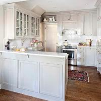 TerraCotta Properties - kitchens - gray cabinets, kitchen cabinets, gray kitchen cabinets, shaker cabinets, gray shaker cabinets, gray shaker kitchen cabinets, marble top, marble countertop, white subway tile, white subway tile backsplash, kitchen hood, disguised kitchen hood, hidden cabinet, hidden kitchen cabinet, end cabinets, gray end cabinets, hidden cabinets, secret cabinets, hidden end cabinets, secret end cabinets, gray corbels, kitchen peninsula, gray kitchen peninsula, breakfast bar, marble breakfast bar, marble top breakfast bar, secret cabinets, kitchen hood, disguised kitchen hood, hidden cabinet, hidden kitchen cabinet, gray kitchen hood, wood paneled hood, gray kitchen hood, gray paneled hood, gray paneled kitchen hood, persian rug, kitchen persian rug,