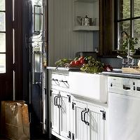 Kathryn Scott Design Studio - kitchens - country kitchen, country cabinets, country kitchen cabinets, beadboard cabinets, white beadboard cabinets, beadboard kitchen cabinets, white beadboard kitchen cabinets, oil rubbed bronze hardware, honed black countertops, honed countertops, black countertops, farmhouse sink, gooseneck faucet, beadboard kitchen, white beadboard kitchen, beadboard backsplash, white beadboard backsplash, window moldings, stained window moldings, kitchen window moldings, white dishwasher, slate gray walls, slate gray kitchen walls, built-ins, kitchen built ins, open shelving,