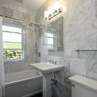 Design Build 4U Chicago - bathrooms - white bianco carrara tiled walls, bianco carrara marble, marble tiled bathroom, bianco carrara marble tile, kohler memoirs toilet, pedestal sink, kohler memoirs pedestal sink, mirror fronted medicine cabinet, polished nickel wall sconce, polished nickel triple wall sconce, combination shower and bath, white shower curtain, frosted glass bathroom window, glass shelf, polished chrome shower curtain pole, solid white shower curtain, polished chrome shower head, polished chrome faucet, light gray walls, floor to ceiling tiled walls, small bathroom, marble tiled bathroom, white bianco carrara marble, bianco carrara marble,
